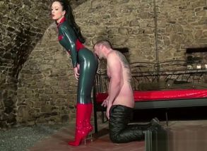 dominatrix in catsuit wants jism on..