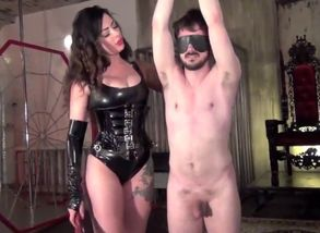 Tall Domina Tantalizes Victim with..