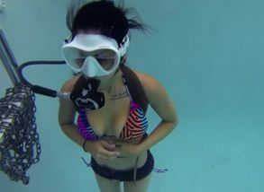 scuba in pool with flooded mask